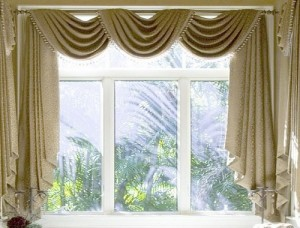 Dazzling window curtains make small space home delightful.