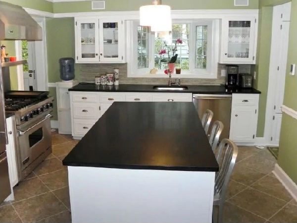 White-black kitchen cabinet island with green walls for kitchen interior design