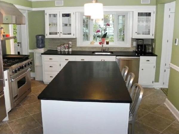 White-black kitchen cabinet island with green walls for kitchen interior design
