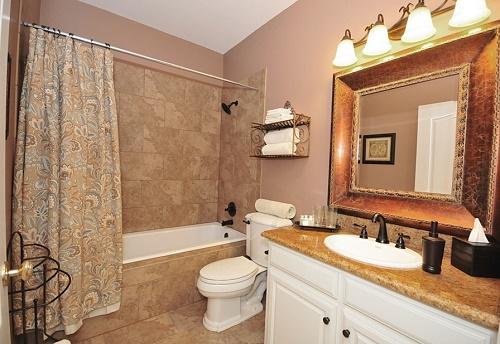 Beige color bathroom interior design.