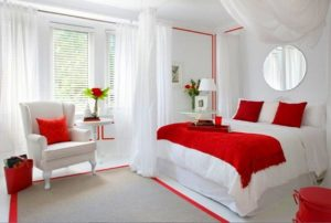 Romantic white-red bedroom decor for couples.
