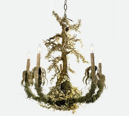 Chandelier that appears next to forest.