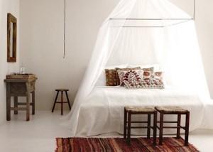 White bed netting for room.