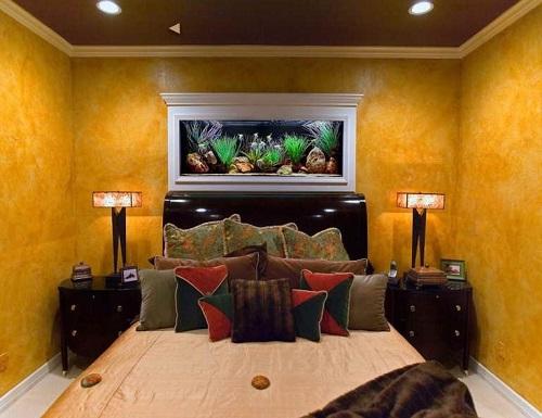 Aquarium just above bed in girls bedroom.