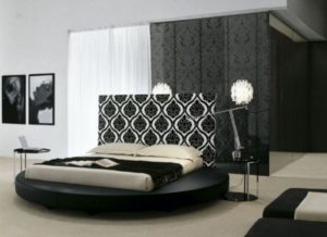 Elegant white and black bedroom design photo.