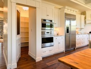 Kitchen cabinet secret door to a room.