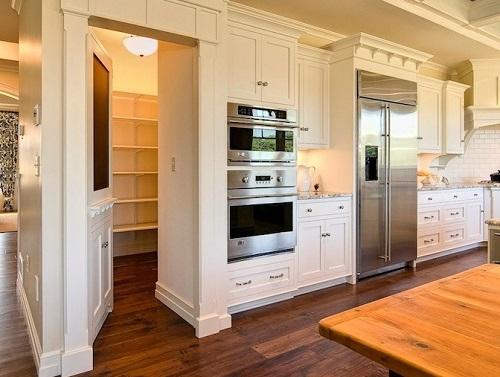 Kitchen cabinet secret door to a room.