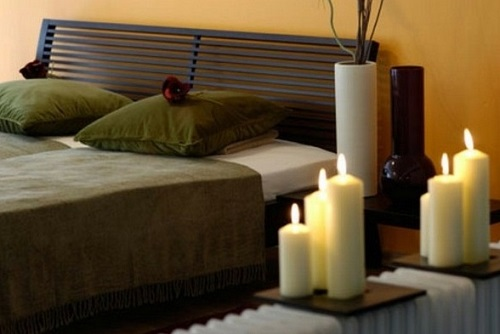 Light scented candles in bedroom.