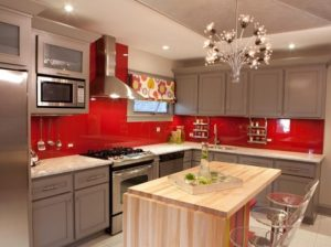 Red kitchen interior walls with oak wood paint.