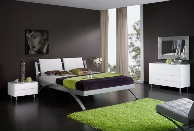 Black bedroom complimented with green rug