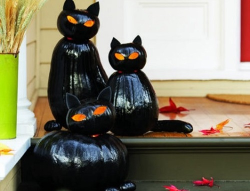 black jack-o-lanterns as cat for halloween day decor