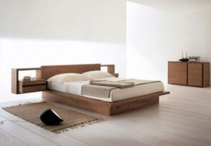 Simple white bedroom design with wooden bed and furniture