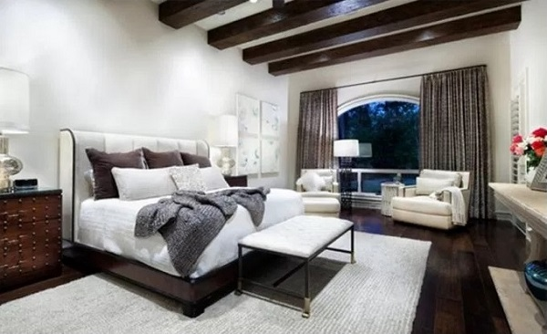 Roof beam introduced to modern brownish bedroom