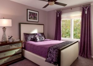 Elegant bedroom design in purple color theme