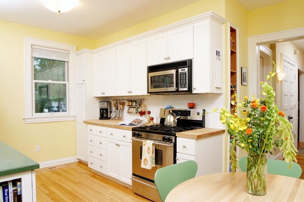White kitchen cabinets for yellow kitchen decoration