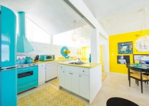 White kitchen island decor with yellow countertop and walls