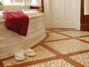 Stone tiles install on bathroom floor