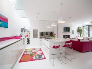 Stylish open pink kitchen design with white theme