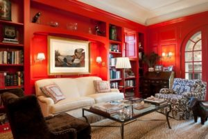 Delicate living room in red colour