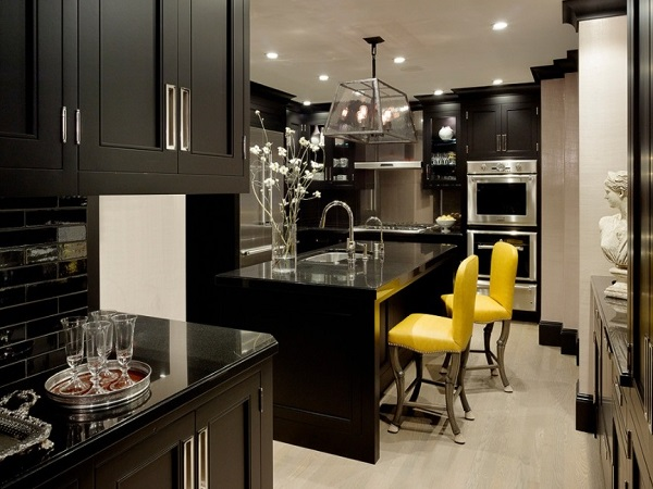 Yellow chairs enhance beauty of black kitchen interior design