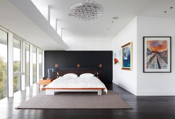 Black wardrobes in white bedroom