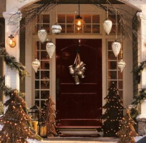 Beautiful Christmas door decorated with Christmas trees
