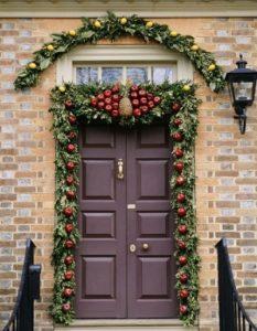 Decor Christmas door with apple, pineapple fruits
