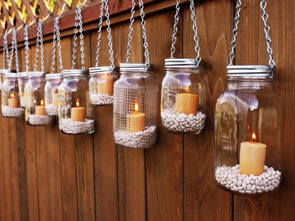 Mason jar holding candle to decorate home for diwali