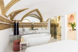 Amazing white bathroom with bathtub installed in Costaguti experience palace in Rome, Italy