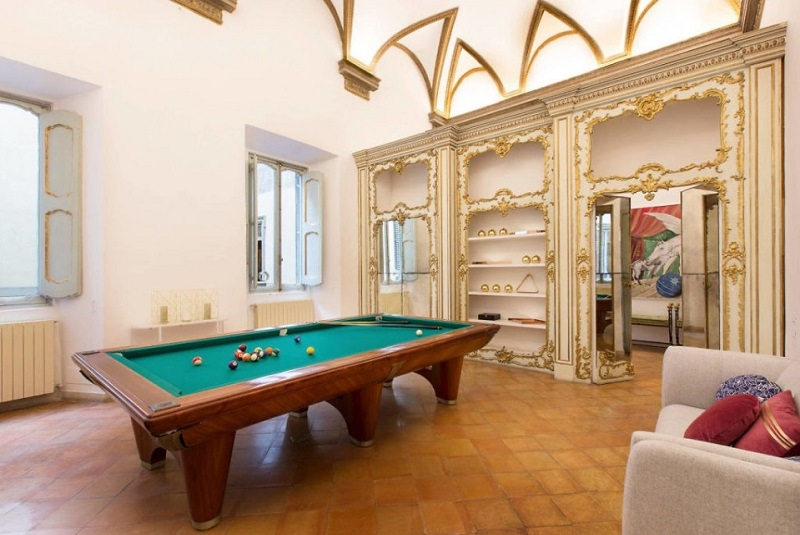 Billiards room decor in Rome's Costaguti Experience apartment